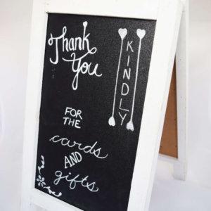white frame chalkboard