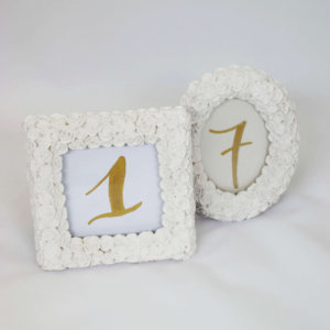 white oval table number frame