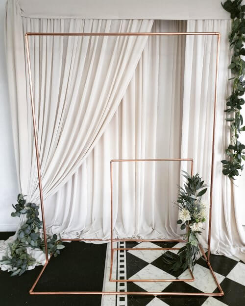 Taupe-backdrop-with-copper-arch