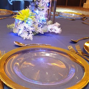 Table setting with gold rim glass charger plate